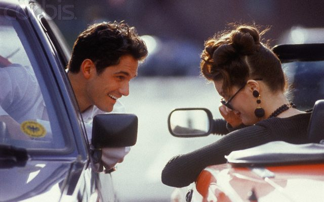 Young man in a car and young woman in a convertible --- Image by © Targa/Corbis