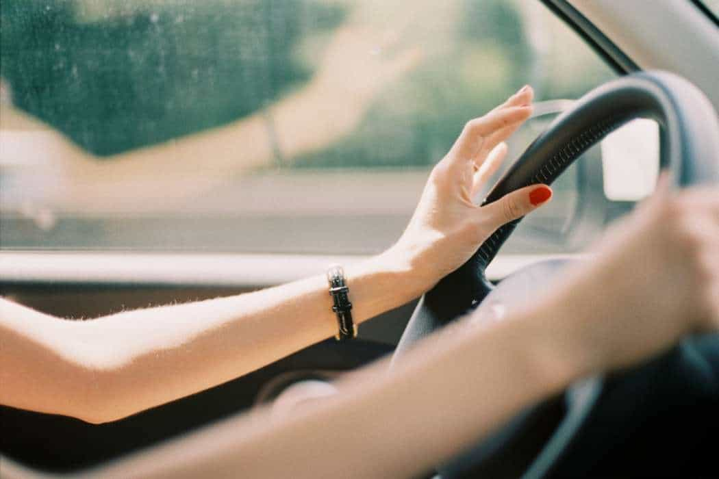 Young woman driving car