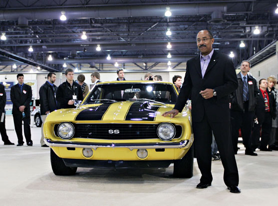 General Motors Vice President Global Design Ed Welburn stands with his personal 1969 Chevy Camaro during the Chevrolet press conference at the Philadelphia International Auto Show Friday, February 2, 2007 in Philadelphia, PA. (General Motors Photo/Emile Wamsteker) (USA)